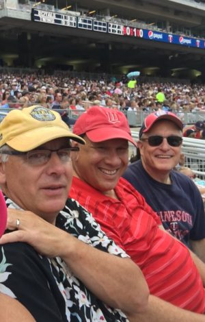 Three old guys at the game.